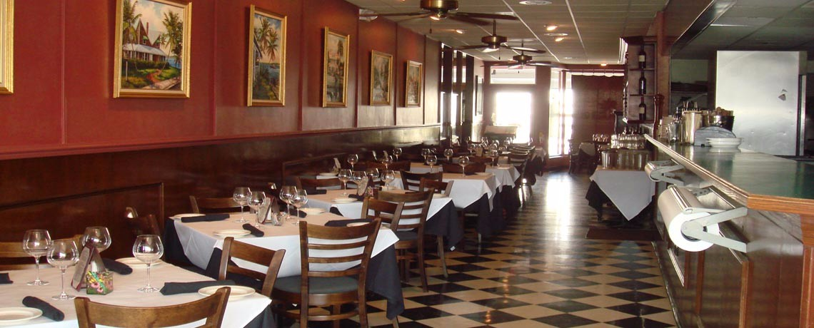 South FL restaurant for sale, indoor photo, chairs checkered floor